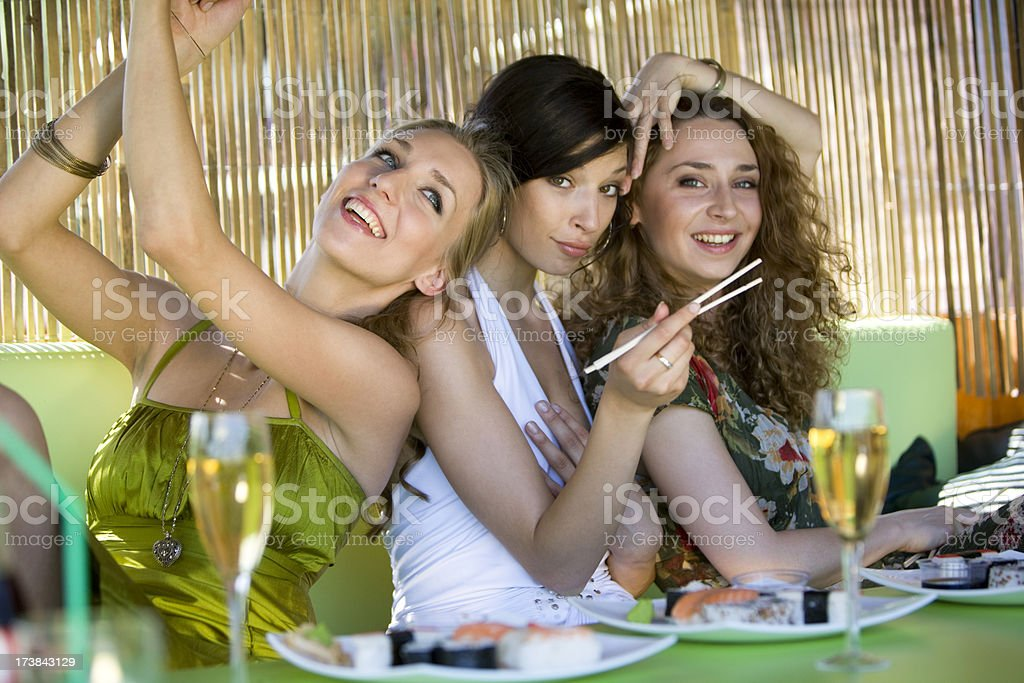 Friends at dining table royalty-free stock photo
