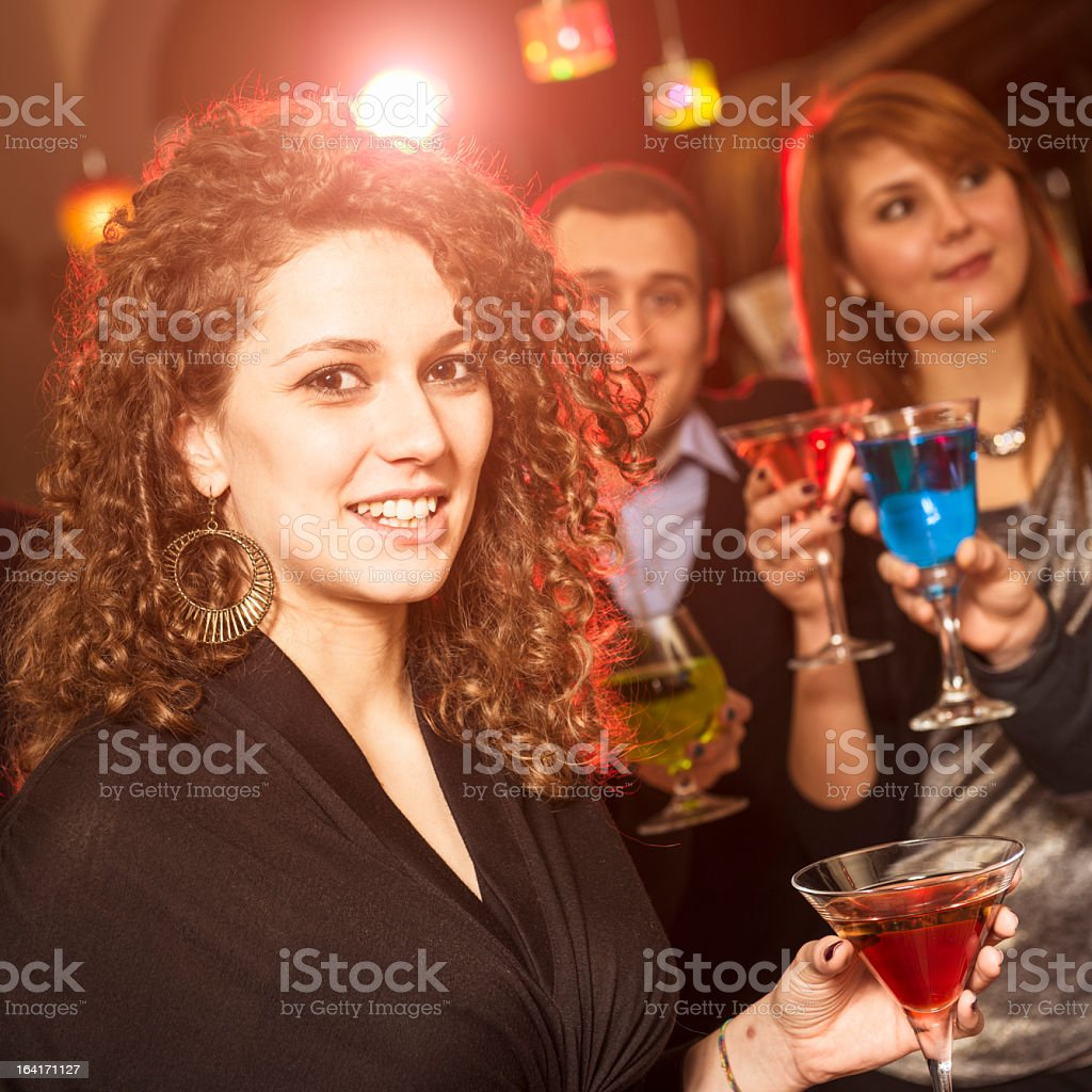 Friends at disco club having fun royalty-free stock photo