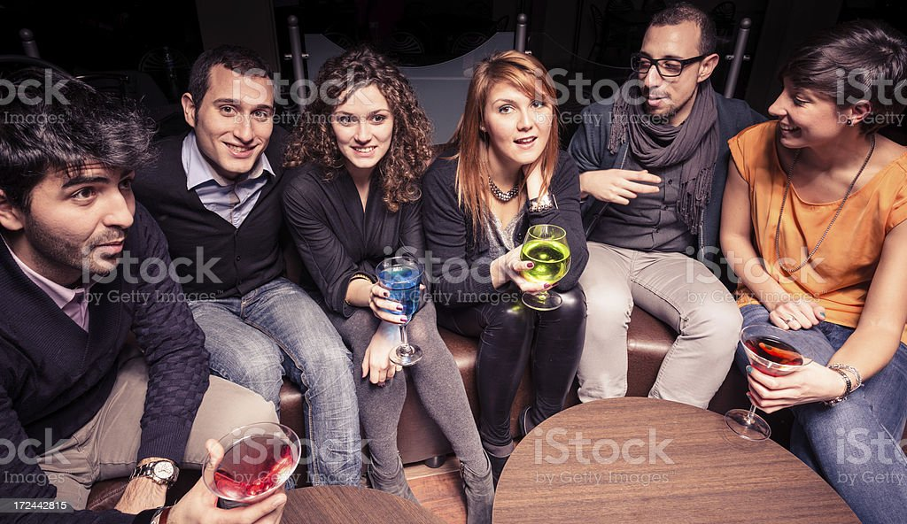 Friends at disco club having fun royalty-free stock photo
