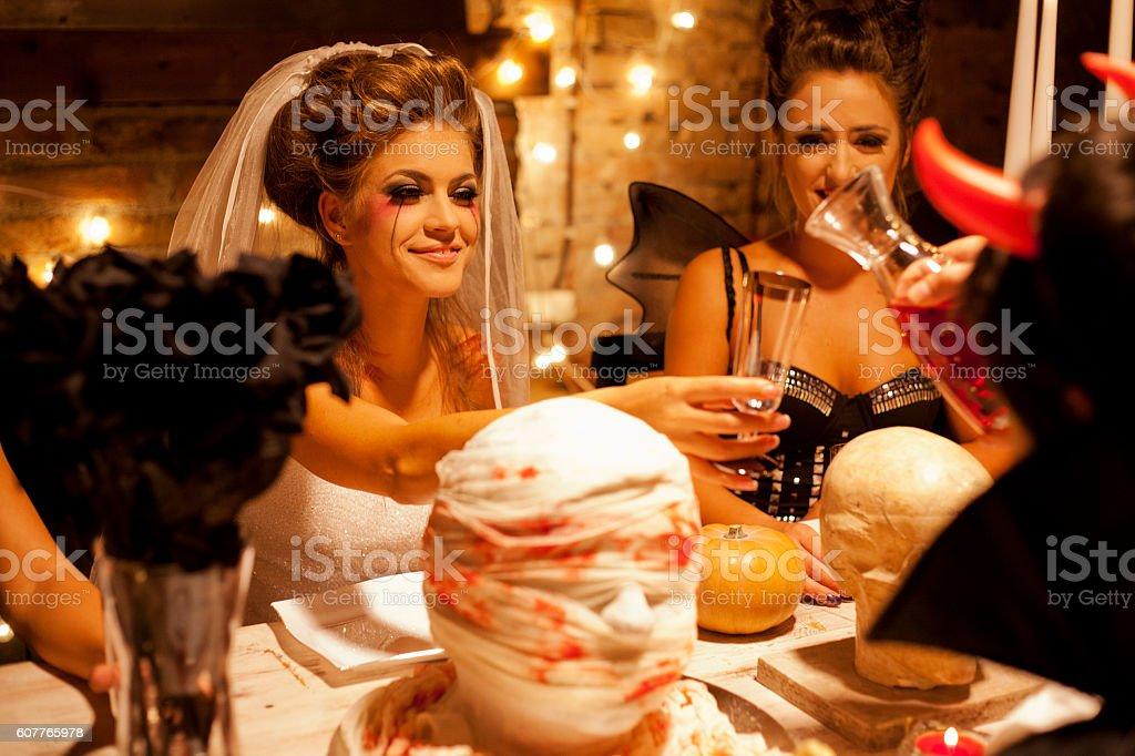 Friends at Halloween dinner stock photo