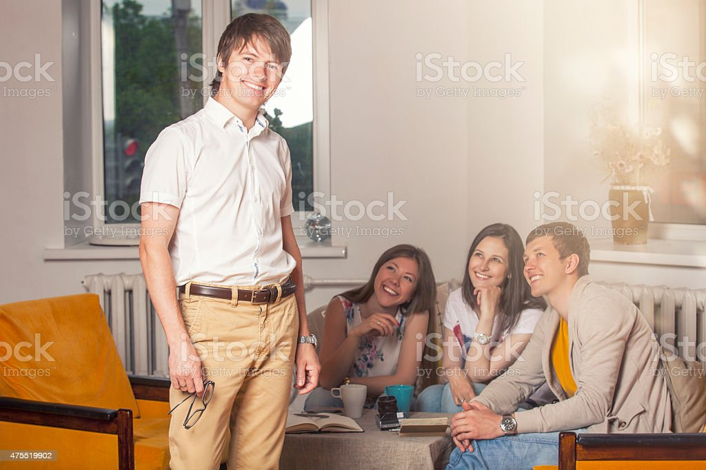 Friends at home and communicate via the process stock photo
