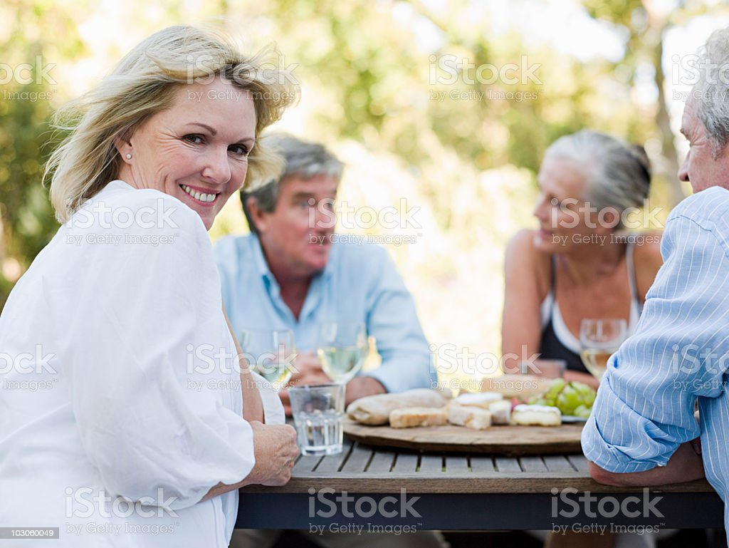 Friends at meal outdoors stock photo