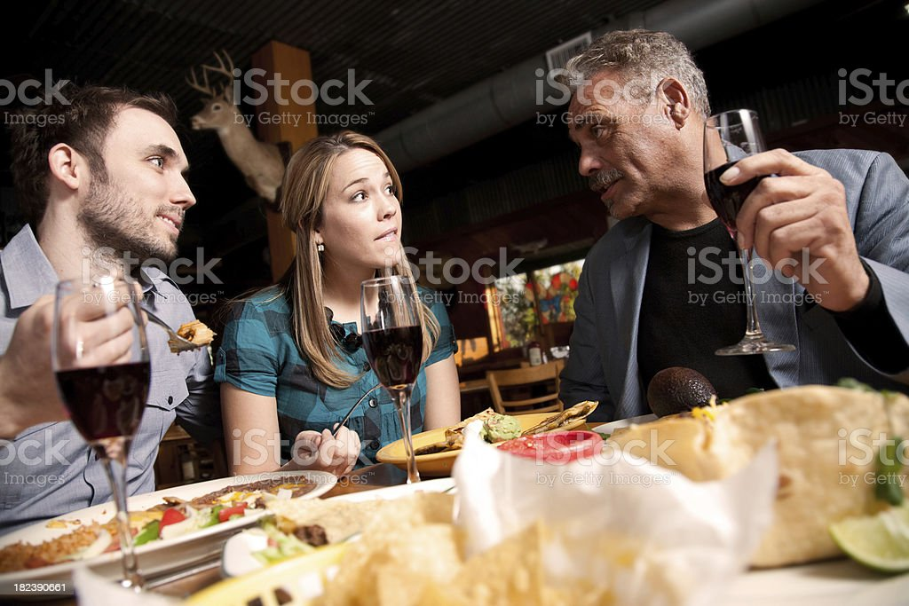 Friends at Mexican Food Restaurant Eating Dinner Together royalty-free stock photo