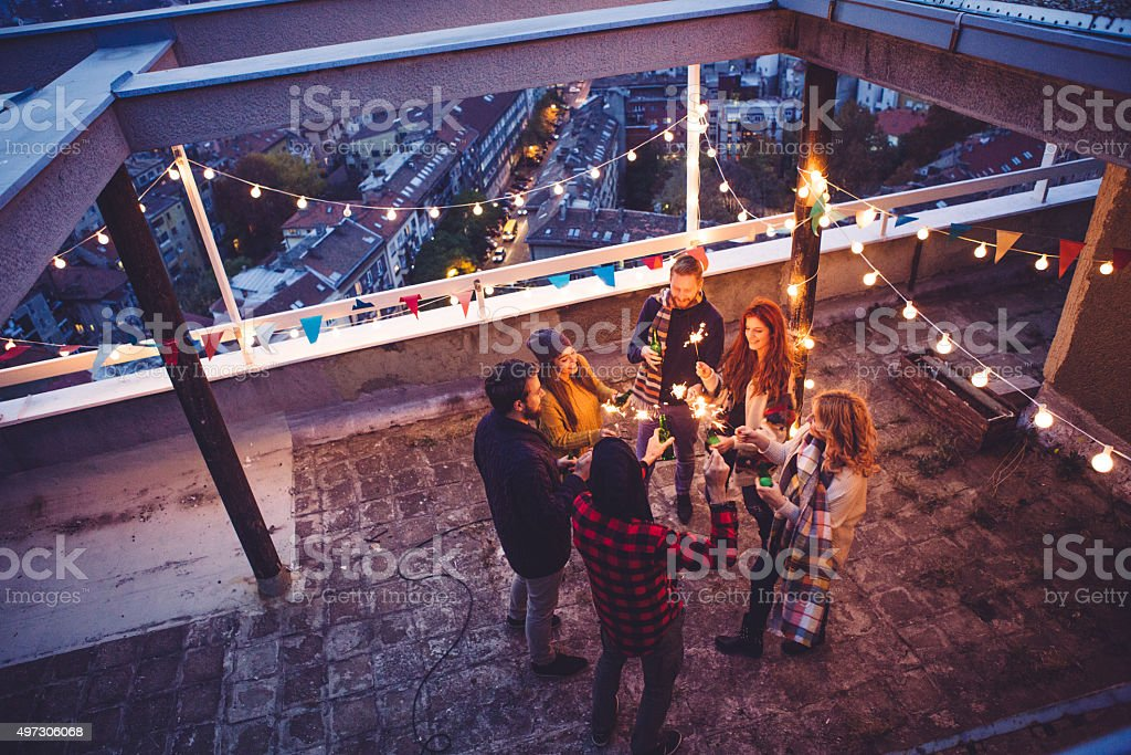 Friends at rooftop party stock photo