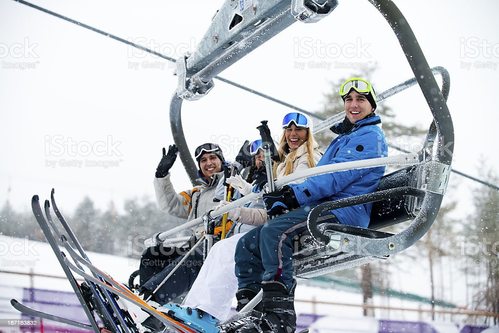 Friends at ski lift stock photo