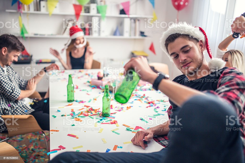 Friends at the office partying stock photo