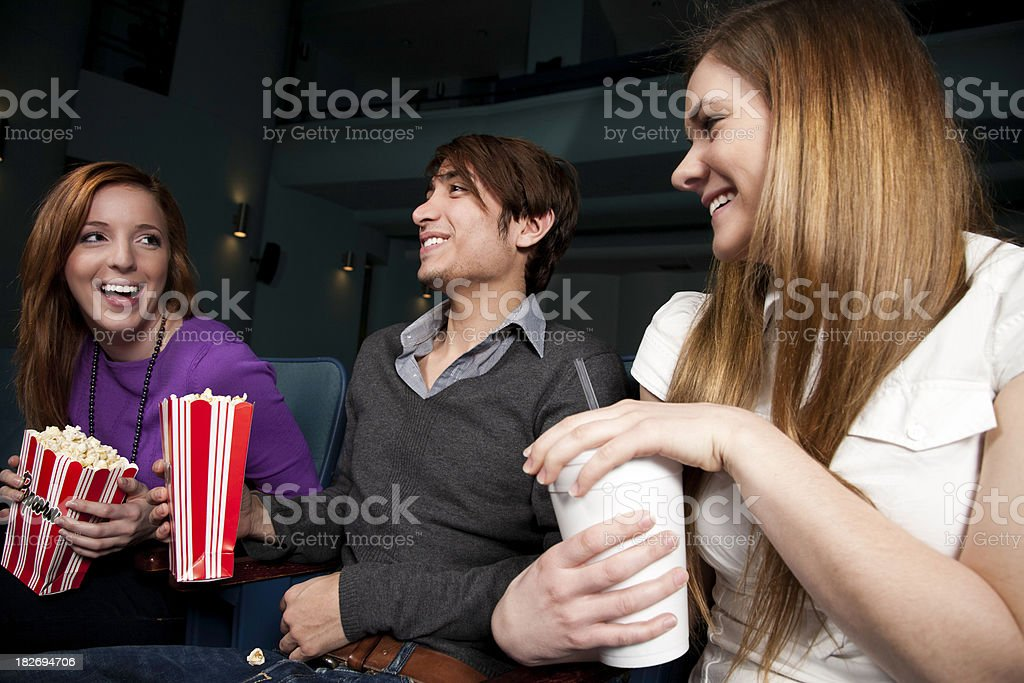 Friends at the Theater Waiting for Movie to Start royalty-free stock photo