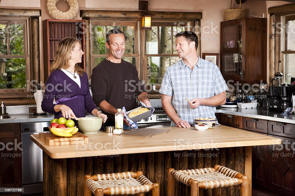 Friends Baking in Kitchen royalty-free stock photo