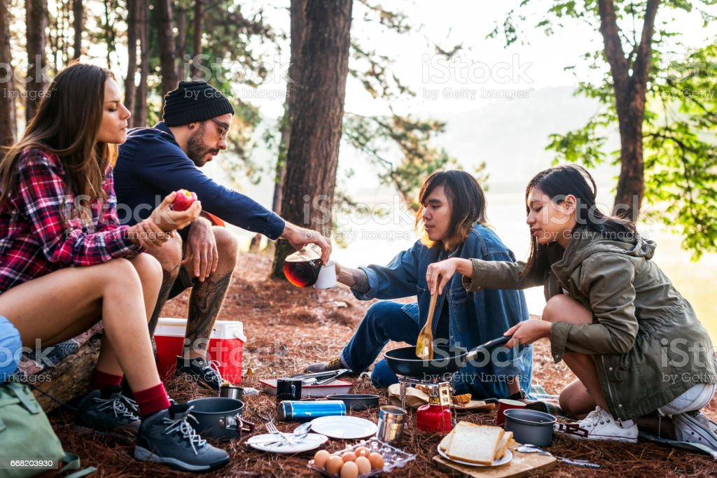 Friends Camping Eating Food Concept stock photo
