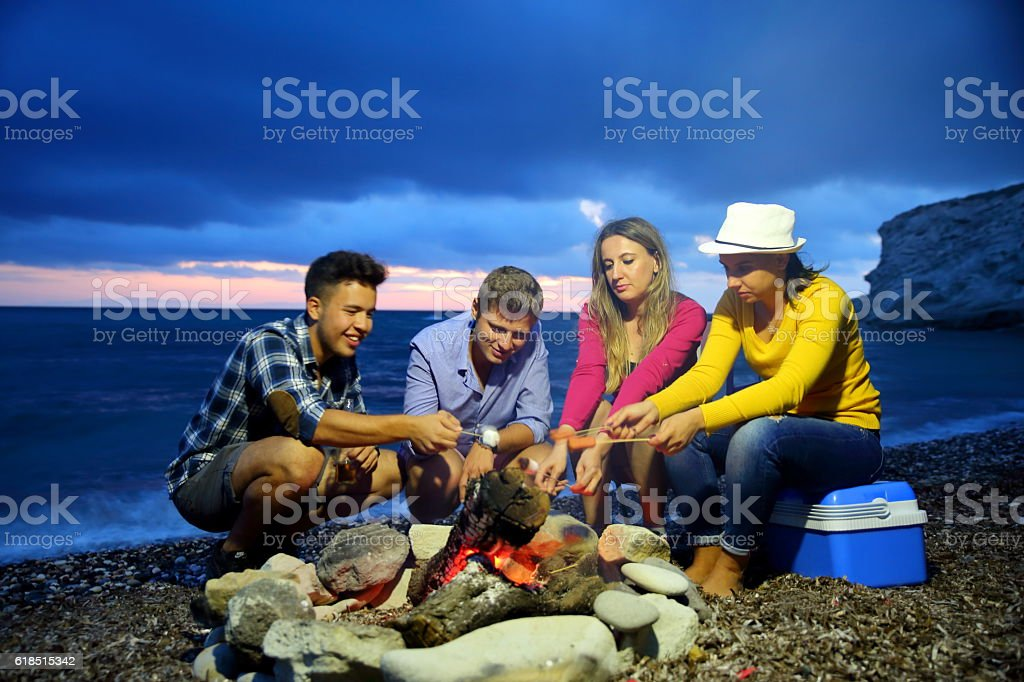 Friends camping on beach stock photo