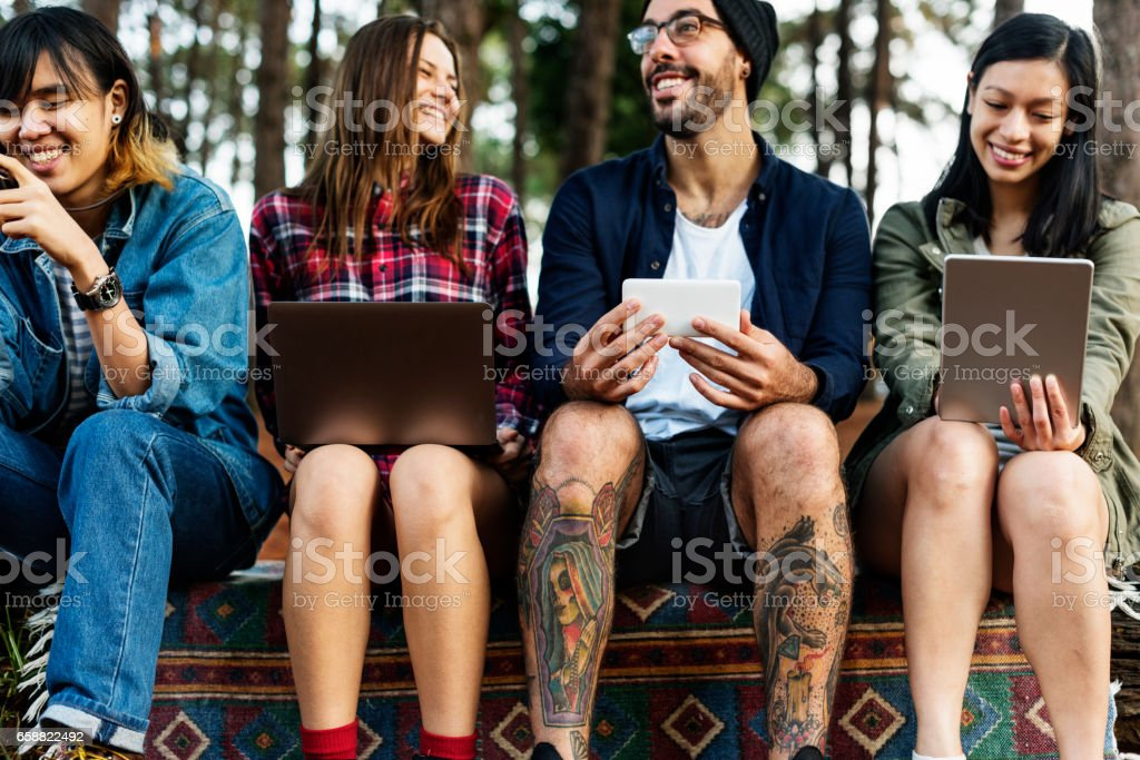 Friends Camping Outdoors Technology Concpt stock photo
