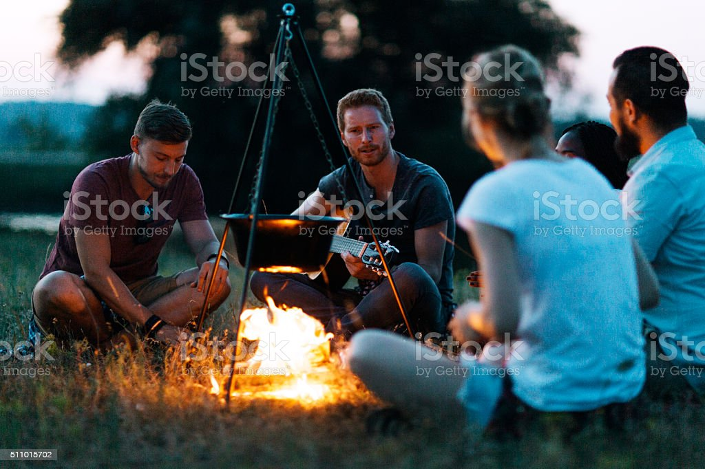 Friends camping together in nature stock photo
