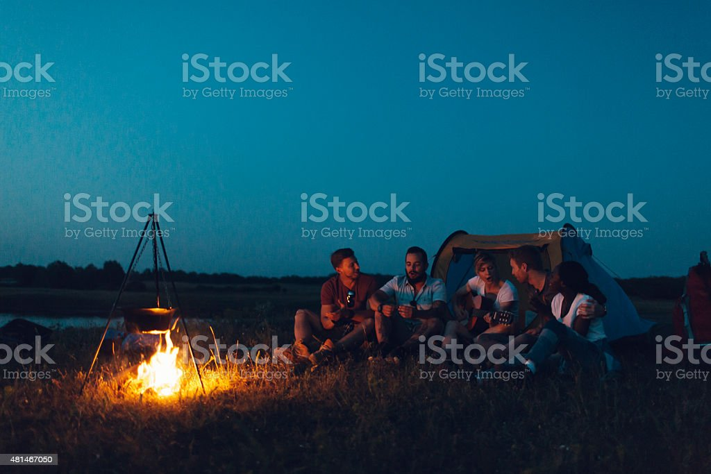 Friends camping together. stock photo
