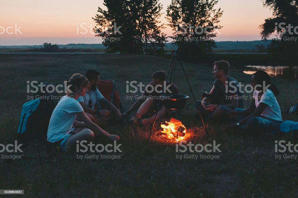 Friends camping together stock photo