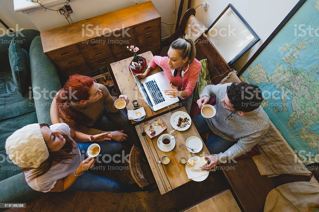 Friends Catching Up Over Coffee stock photo