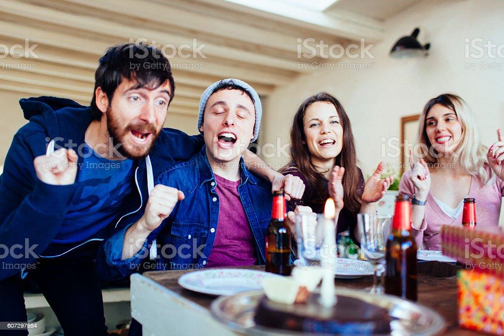Friends celebrating a birthday in a loft. stock photo