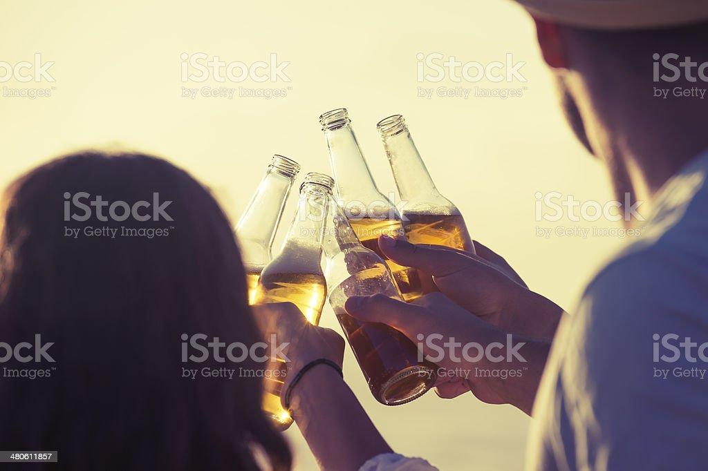 Friends celebrating at sunset royalty-free stock photo