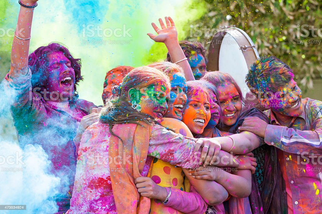 Friends Celebrating Holi Festival in India stock photo