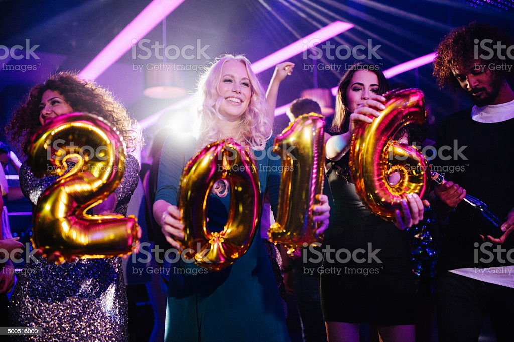 Friends celebrating New Years Eve at Nightclub party stock photo