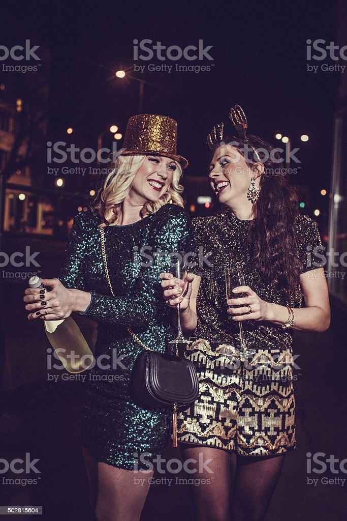 Friends celebrating new years eve outdoors stock photo
