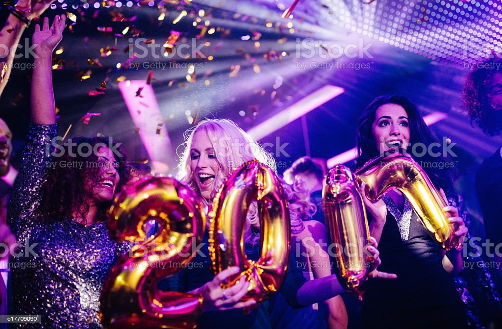 Friends celebrating New Years eve with a night club party stock photo