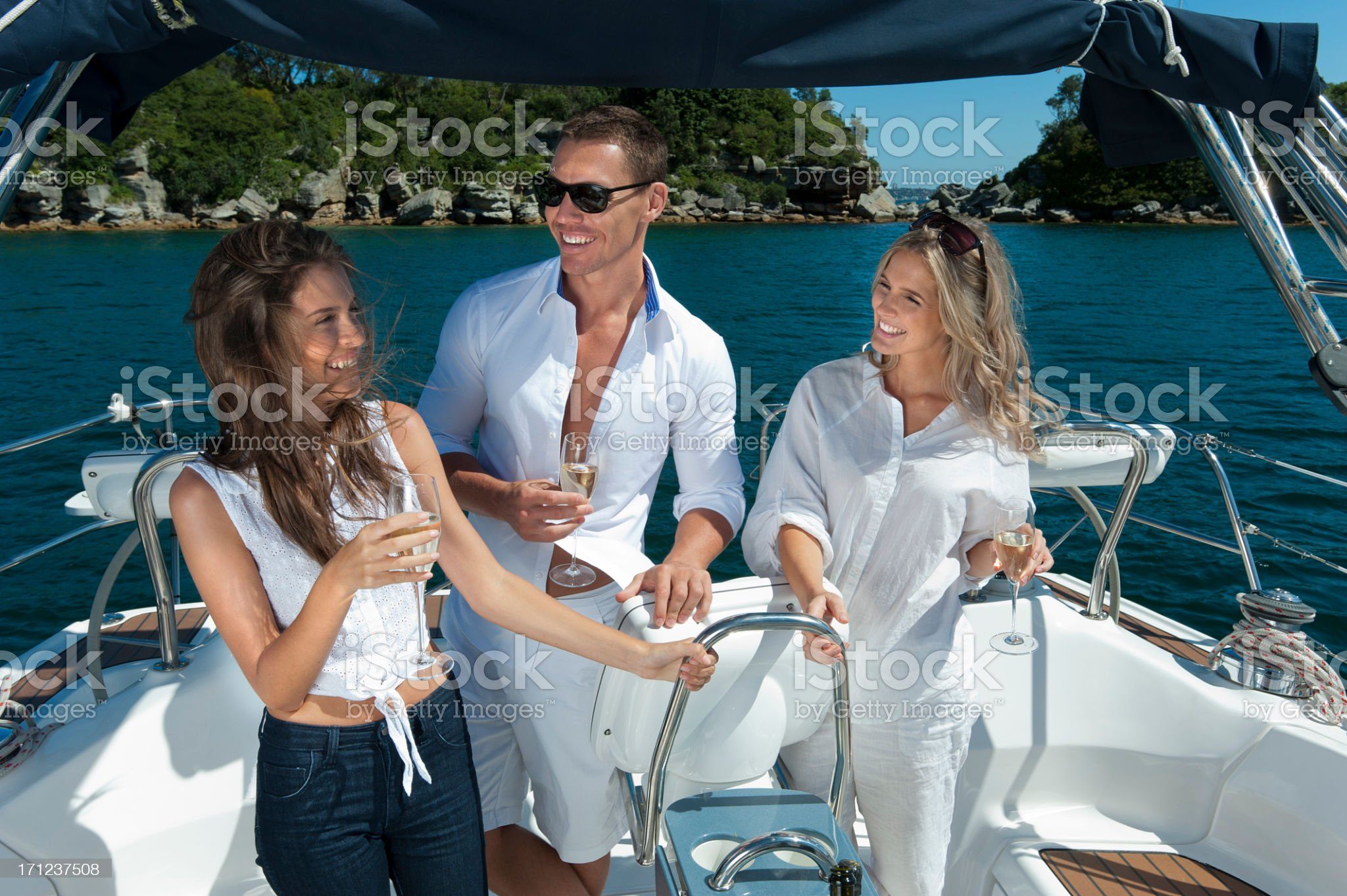 Friends celebrating on boat with glass of champagne royalty-free stock photo