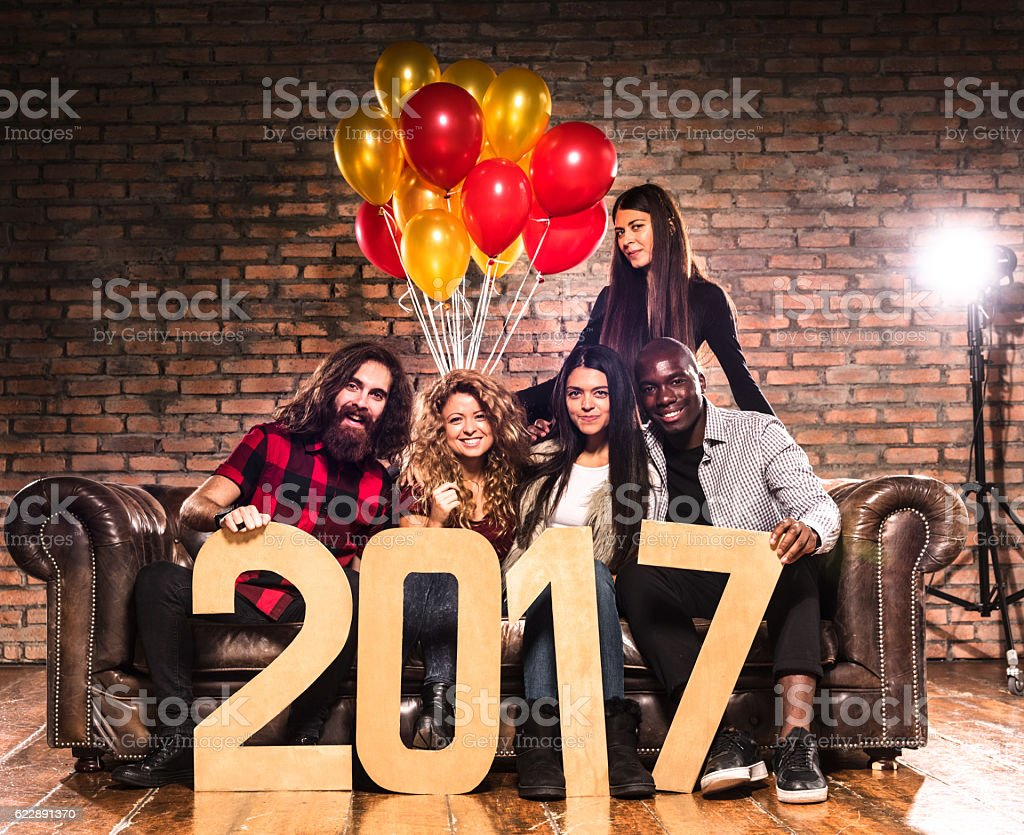 Friends celebrating the new year 2017 together stock photo