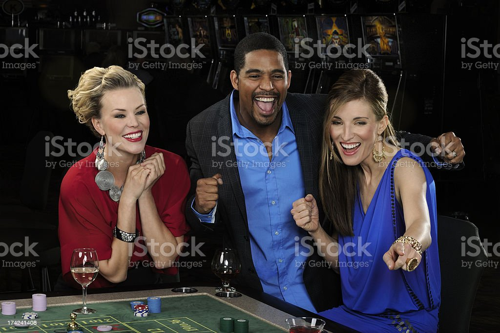Friends Celebrating Their Good Luck at a Casino stock photo