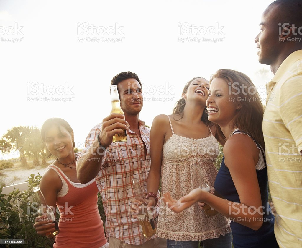Friends celebrating with beer on a spring break vacation royalty-free stock photo