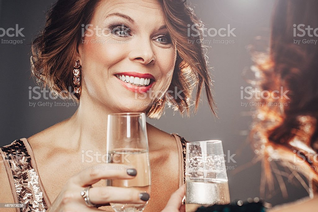 Friends celebrating with champagne and socializing stock photo