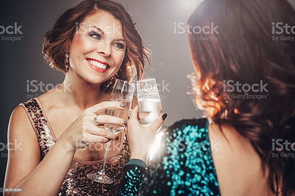 Friends celebrating with champagne stock photo