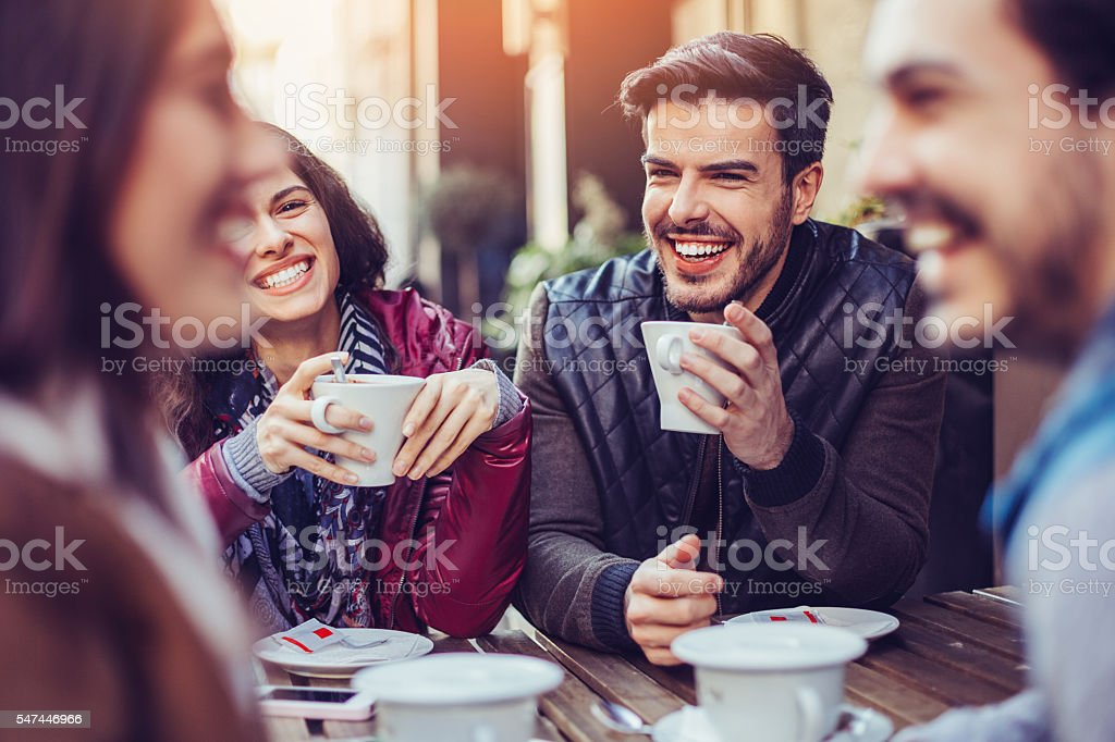 Friends chatting in cafe stock photo