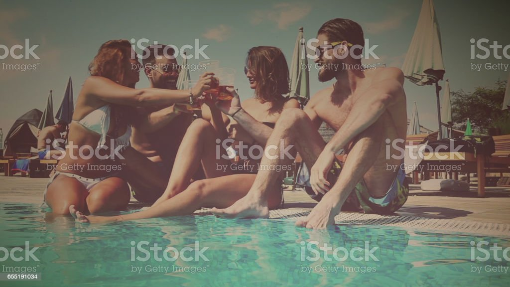 Friends chilling at the pool stock photo