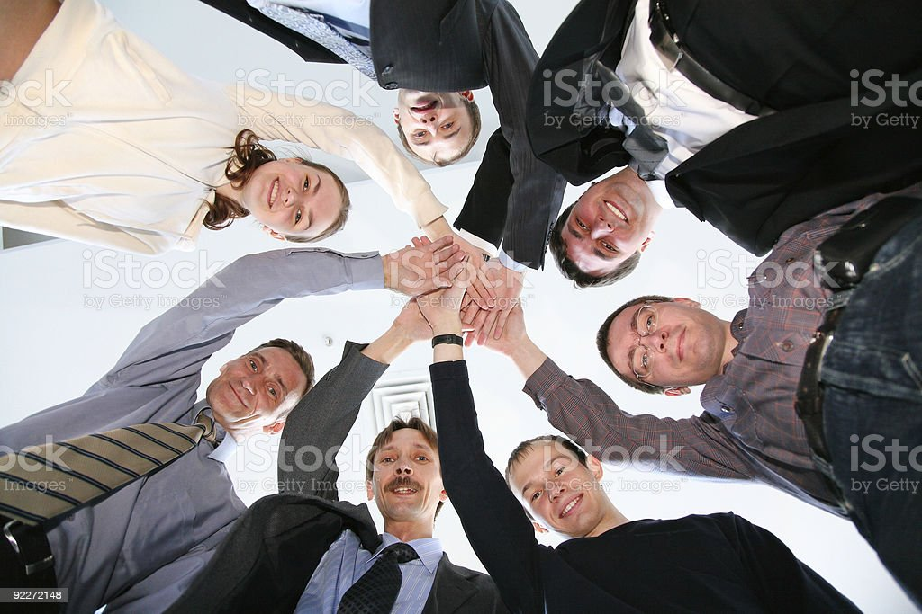 friends circle with hands stock photo