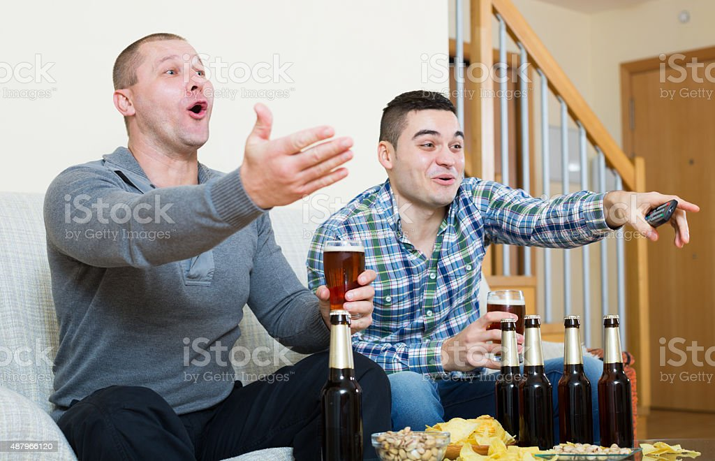 friends  commenting sport tv channel stock photo