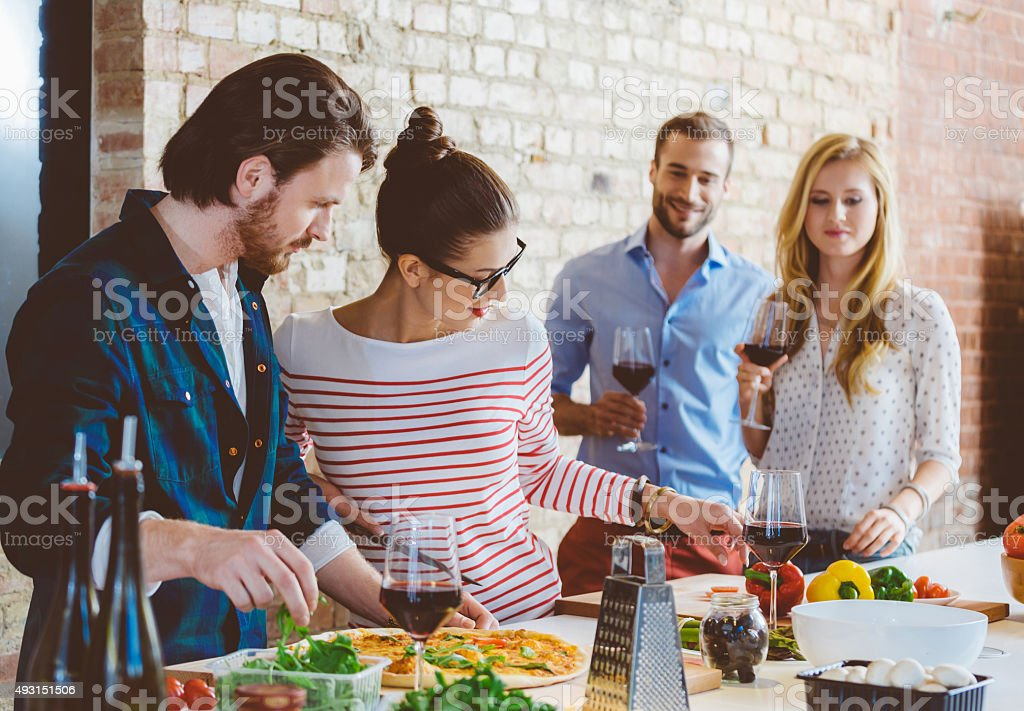 Friends cooking together stock photo
