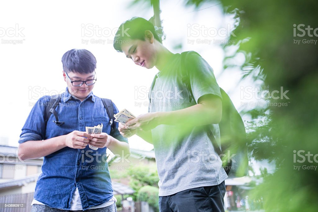 Friends counting the cash stock photo