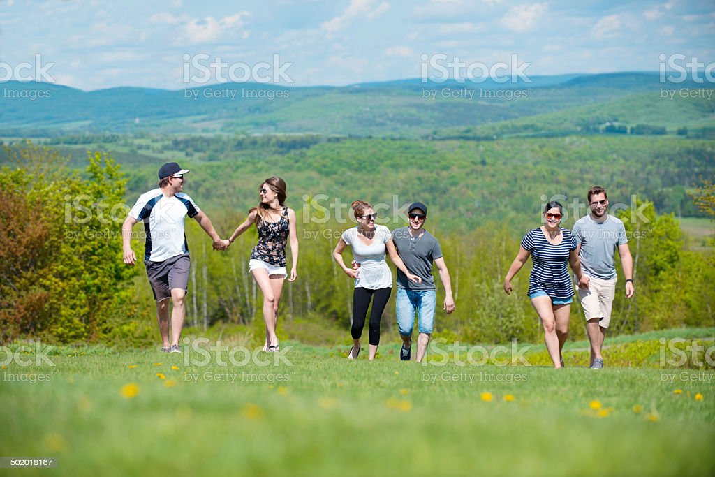 Friends couple walking in spring landscape stock photo