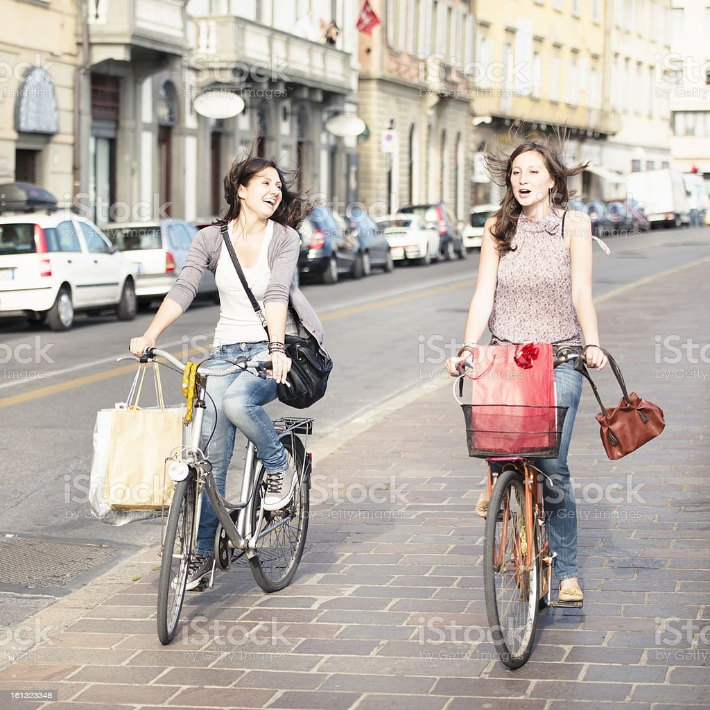 Friends cycling on the city - urban scene royalty-free stock photo