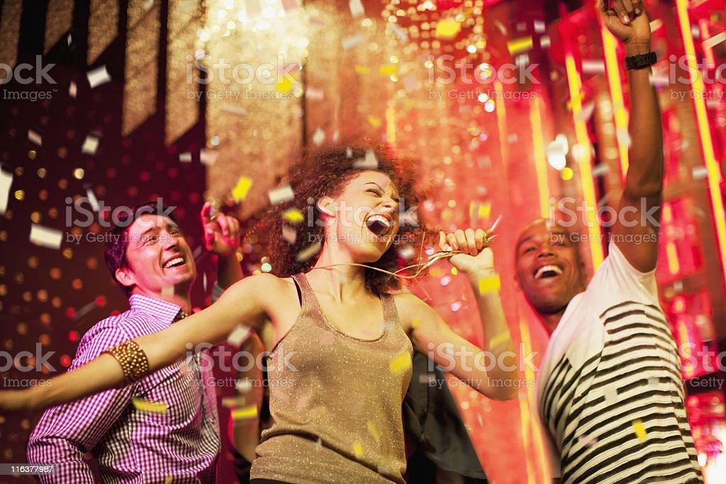 Friends dancing at nightclub royalty-free stock photo