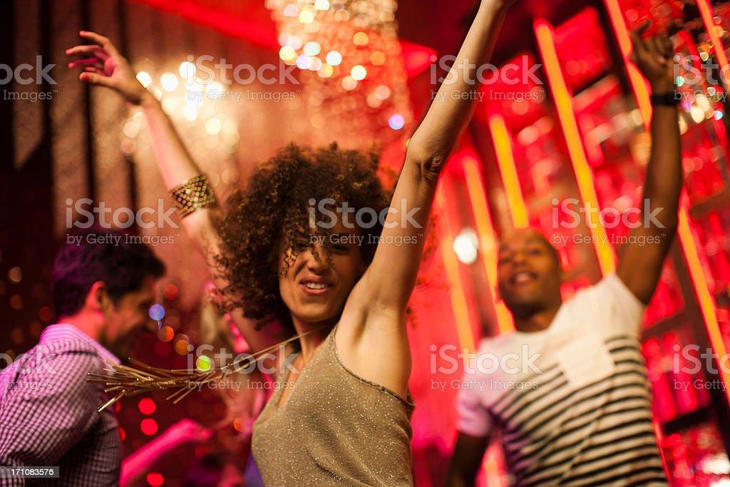 Friends dancing at nightclub stock photo