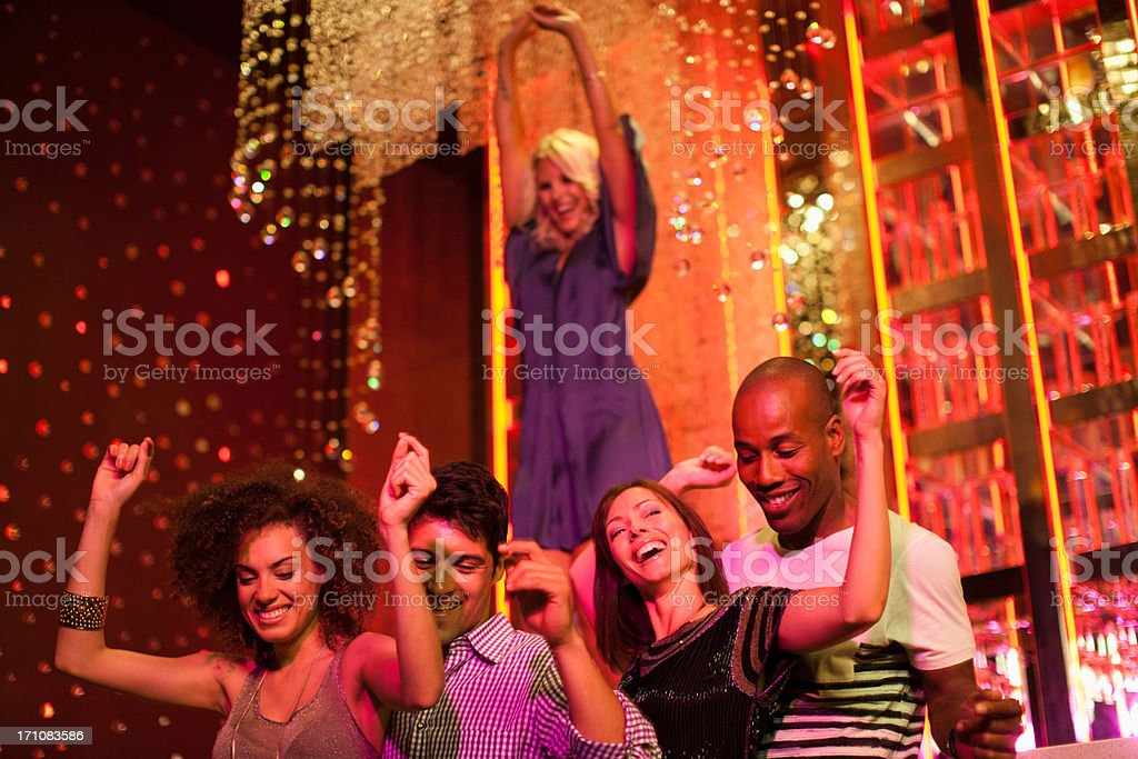 Friends dancing at nightclub stock photo