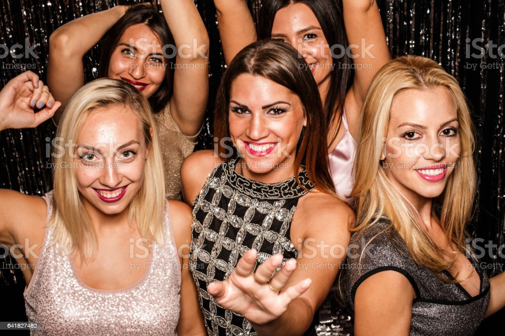 Friends dancing on a party stock photo