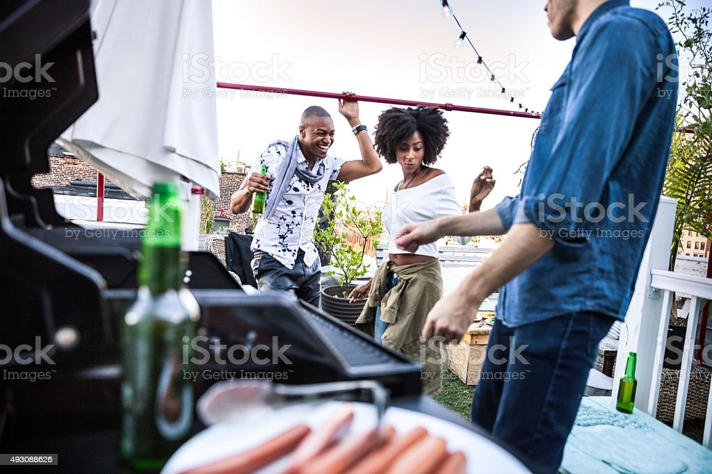 Friends dancing on a rooftop in New York Manhattan stock photo