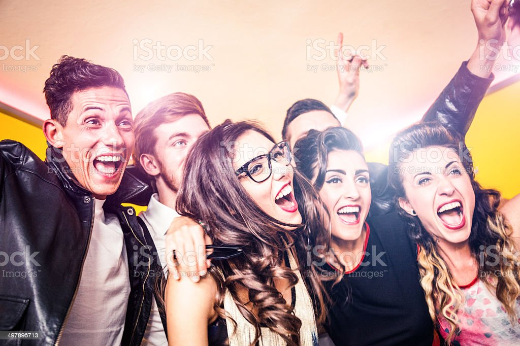Friends dancing together at a party stock photo