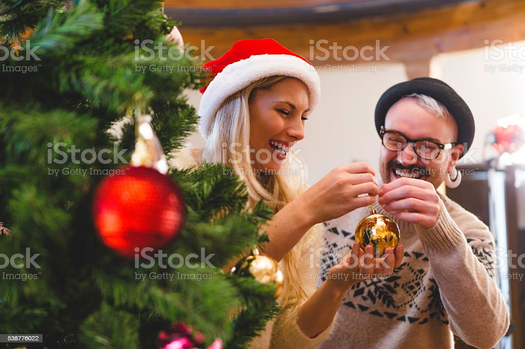 Friends Decorating the Tree stock photo