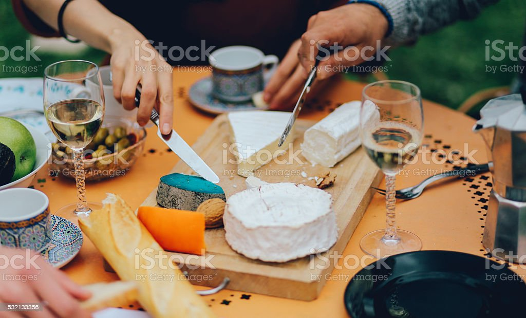 Friends dining in the suburban garden of Paris stock photo
