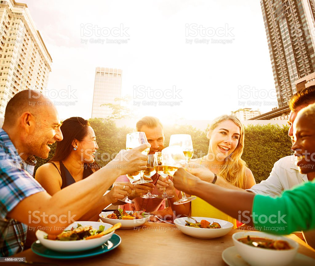 Friends Dining Outdoors Party Cheerful Toast Concept stock photo