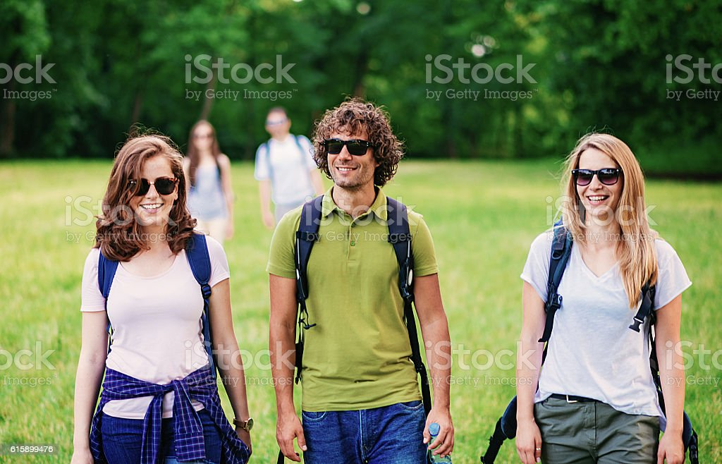 Friends discovering beauties in nature stock photo