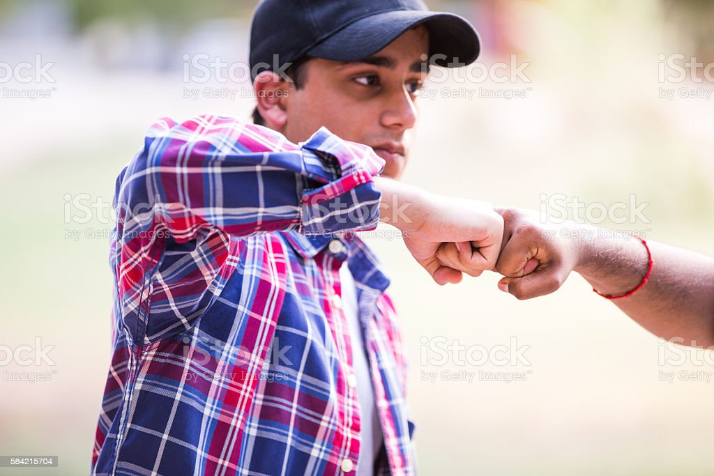 Friends doing a Fist Bump stock photo